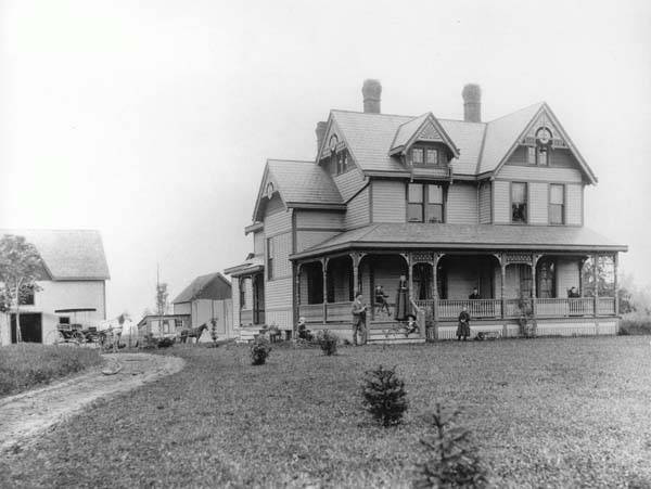 Dean Dairy, Circa 1900: Orville A. Dean bult this farmhouse and its adjoining buildings at 3151 Mayfield Road in 1886 to house the OA Dean Dairy Co. By 1920, the house had been moved down the road to 3211 Mayfield Road, where it stood until being demolished to make way for a modern dairy complex in the years following World War II. These newer buildings still remain and are now occupied by a U-Haul rental facility.