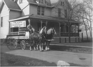 Horse-Drawn Delivery, 1934: A horse-drawn milk delivery wagon sits in front of the Dean Dairy headquarters during the company's 50th anniversary in 1934. Horse-drawn wagons had provided home delivery to Dean's customers since its earliest years, though the horses were eventually phased out and replaced by automobiles in the years following World War II.